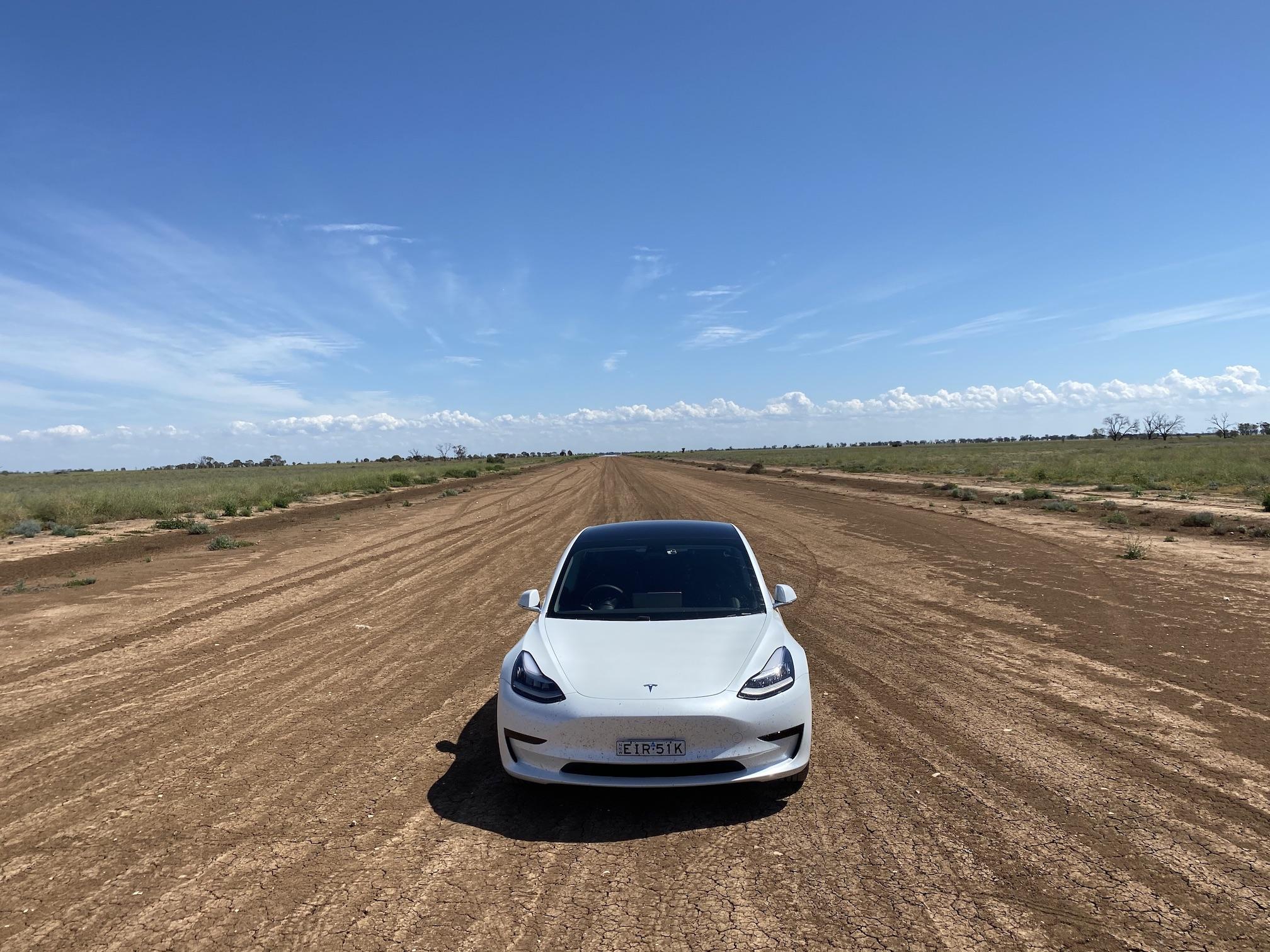 tesla on dirt road